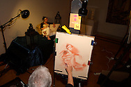 Artist Greg Dearth works on a Conte drawing of model Stephanie Elsass during the 2011 Art Ball at the Dayton Art Institute, Saturday, June 11, 2011.  Elsass says although she's modeled for large groups before, this is the first time she's had a large audience watching not only her, but the four artists taking part of the live figure drawing as well.  It's estimated there were more than 800 attending this years event.
