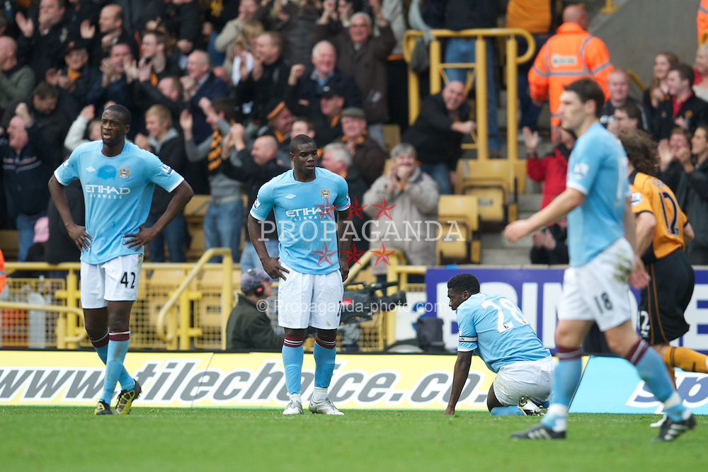 WOLVERHAMPTON, ENGLAND - Saturday, October 30, 2010: Manchester City's Yaya Toure and Micah Richards look dejected as Wolverhampton Wanderers score the second goal during the Premiership match at Molineux. (Pic by: David Rawcliffe/Propaganda)