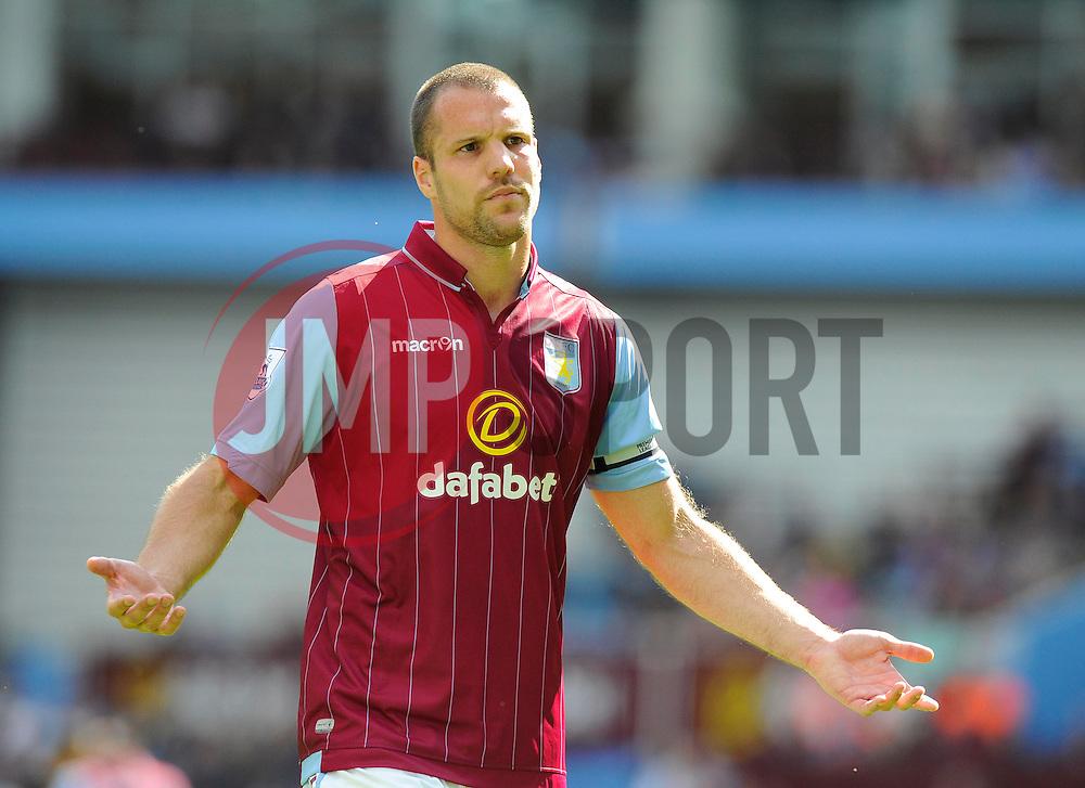 Aston Villa's Ron Vlaar appeals to the Villa fans - Photo mandatory by-line: Joe Meredith/JMP - Mobile: 07966 386802 31/08/2014 - SPORT - FOOTBALL - Birmingham - Villa Park - Aston Villa v Hull City - Barclays Premier League