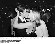 Kissing couple at  the Vanity Fair Oscar Night Party Mortons,  Los Angeles. 25 March 1996<br />