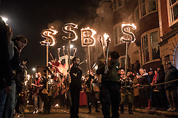 © Licensed to London News Pictures. 05/11/2016. Lewes, UK. Revellers carrying fire sticks walk through the streets of Lewes in East Sussex. The celebrations, which mark the Guy Fawkes 1605 Gunpowder Plot to blow up Parliament, date back to the 1850s. Photo credit: Rob Pinney/LNP