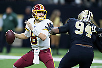NEW ORLEANS, LA - NOVEMBER 19:  Kirk Cousins #8 of the Washington Redskins tries to avoid the rush of Cameron Jordan #94 of the New Orleans Saints at Mercedes-Benz Superdome on November 19, 2017 in New Orleans, Louisiana.  Saints defeated the Redskins 34-31.  (Photo by Wesley Hitt/Getty Images) *** Local Caption *** Kirk Cousins; Cameron Jordan