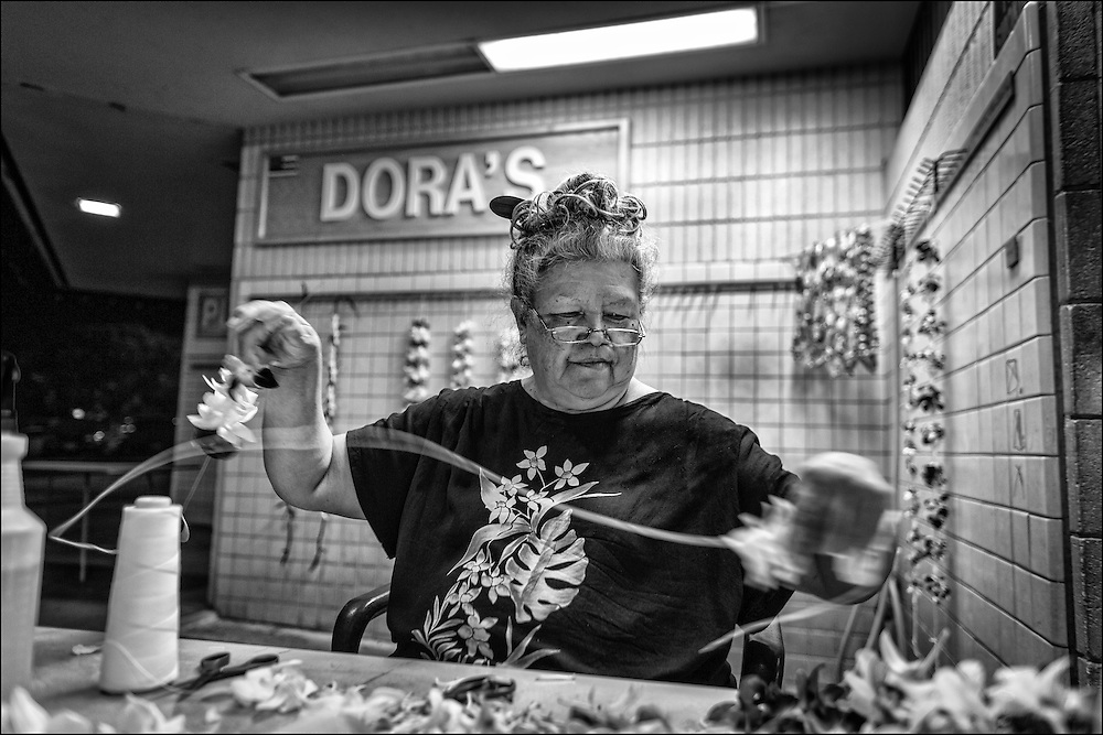 Dora, the daughter of the original Dora, continues the lei making tradition at Honolulu Airport. She drives in from the westside at 4:30am daily and leaves around 10:30pm at night when the last delayed flights usually arrives.