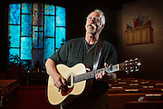 Pastor Scott Taylor plays guitar for a portrait at First Christian Church. Taylor, an accomplished musician, had a career in organic chemistry before becoming a pastor over five years ago. (Independent/Matt Dixon)