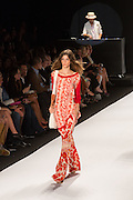 Flare-bottom pants in a red and orange print, and a long tnic top in a similar print.