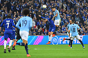Nicolas Otamendi (30) of Manchester City leaps above Gonzalo Higuain (9) of Chelsea to head the ball during the Carabao Cup Final match between Chelsea and Manchester City at Wembley Stadium, London, England on 24 February 2019.