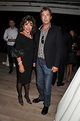 JOAN COLLINS and JULIAN CLARY at a party to celebrate the publication of her  autobiography - The World According to Joan, held at the British Film Institute, South Bank, London SE1 on 8th September 2011.