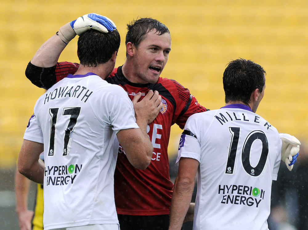 Perth Glory's Todd Howarth, left, Danny Vukovic and Liam Miller celebrate their 1-0 win over the Phoenix in the A-League football match at Westpac Stadium, Wellington, New Zealand, Sunday, January 08, 2012. Credit:SNPA / Ross Setford