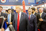 Presidential hopeful, billionaire Donald Trump, arrives with his campaign manager Corey Lewandowski in the spin room after the CNN Republican Presidential Debate at the Venetian Hotel and Casino in Las Vegas.