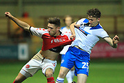 Dan Adshead challenges for the ball during the EFL Trophy match between Fleetwood Town and Rochdale at the Highbury Stadium, Fleetwood, England on 9 October 2018.