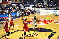 "Mississippi Lady Rebels guard Erika Sisk (5) scores against Georgia Bulldogs guard/forward Shacobia Barbee (20) at the C.M. ""Tad"" Smith Coliseum in Oxford, Miss. on Thursday, January 15, 2015.  (AP Photo/Oxford Eagle, Bruce Newman)"