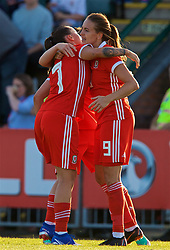 NEWPORT, WALES - Tuesday, June 12, 2018: Wales' Kayleigh Green celebrates scoring the first goal with team-mate Natasha Harding during the FIFA Women's World Cup 2019 Qualifying Round Group 1 match between Wales and Russia at Newport Stadium. (Pic by David Rawcliffe/Propaganda)
