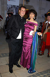 ISAAC SOPHER and NANCY MILLER-JONG at a tribute to Luciano Pavarotti in aid of the British Red Cross held at The Guildhall, City of London on 6th June 2005<br />
