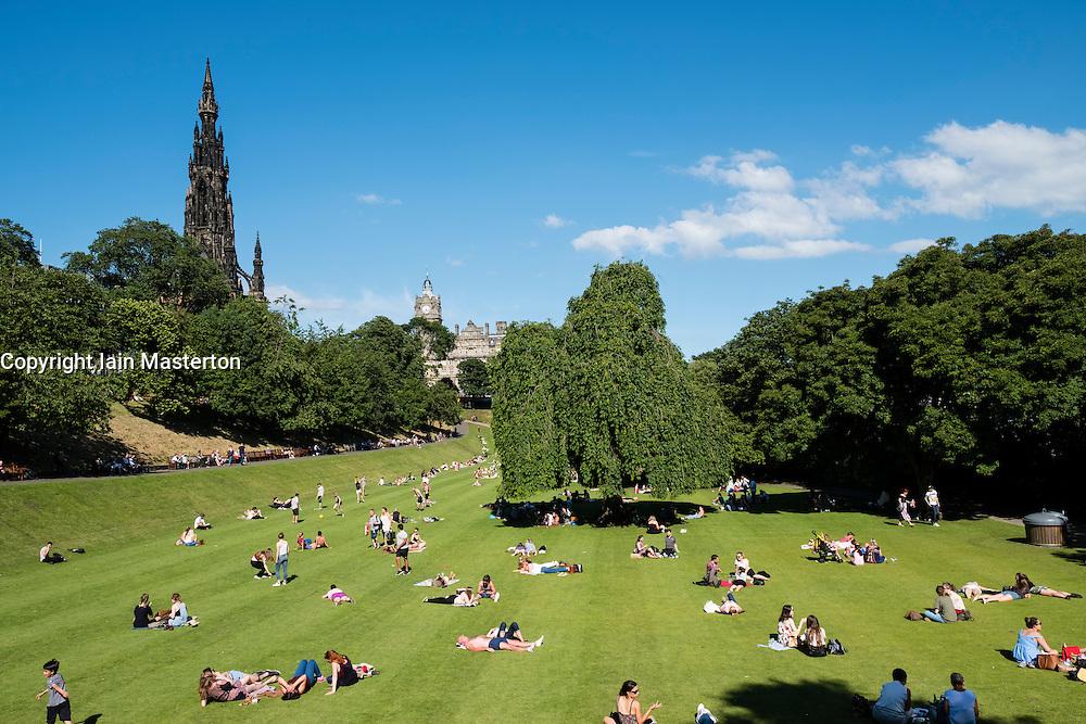 Summer hot weather brings many people into Princes Street Gardens in Edinburgh, Scotland, United Kingdom