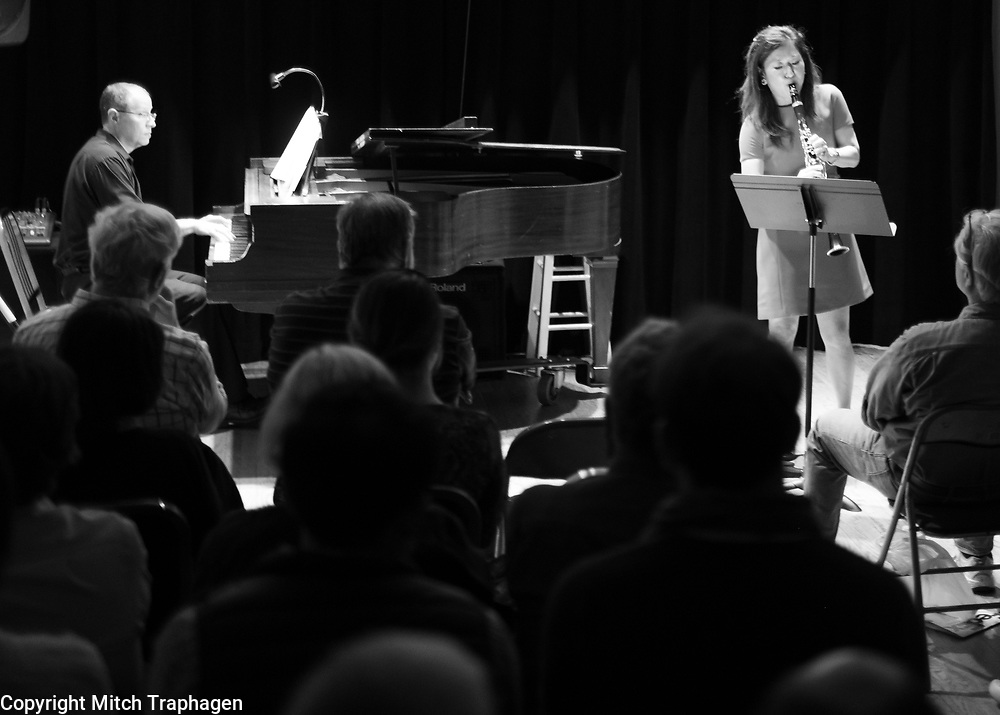 "Seunghee ""Sunny"" Lee performing live at the cell theatre in Manhattan, New York City, with pianist Evan Solomon. A Charles R. Hale Production. May 16, 2018."