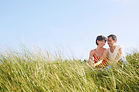 Couple Sitting in Tall Grass