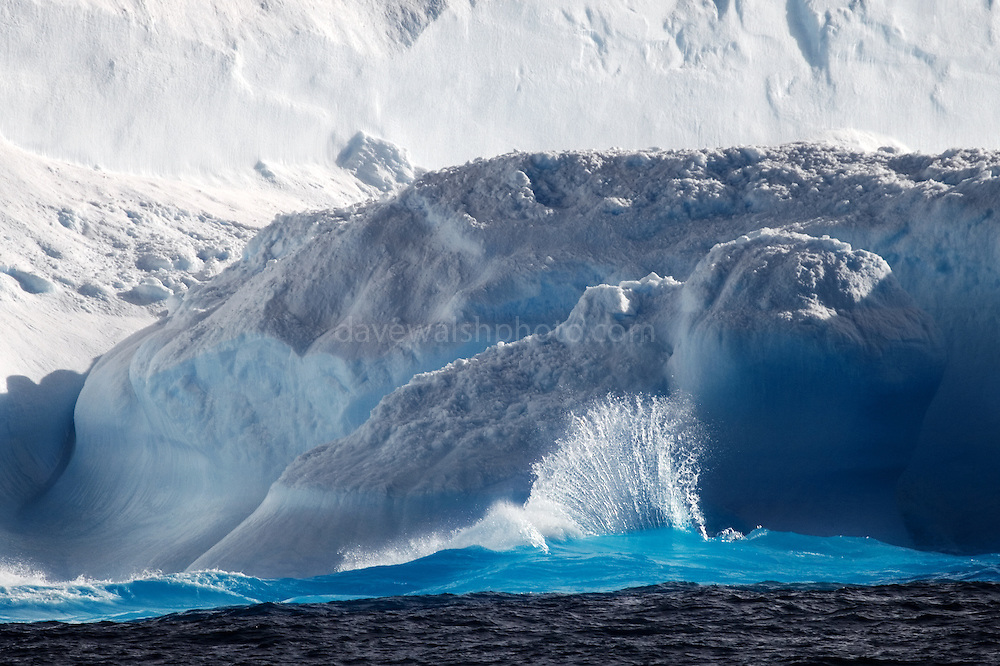 Wave breaking on iceberg, Antarctica