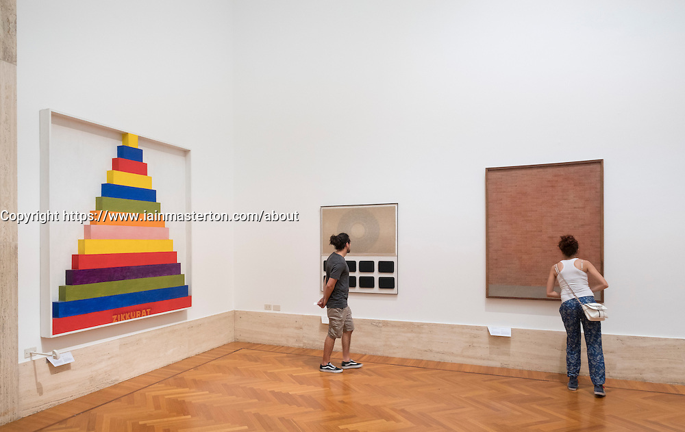 Visitors looking at paintings at National Gallery of Modern and Contemporary Art, Rome, Italy