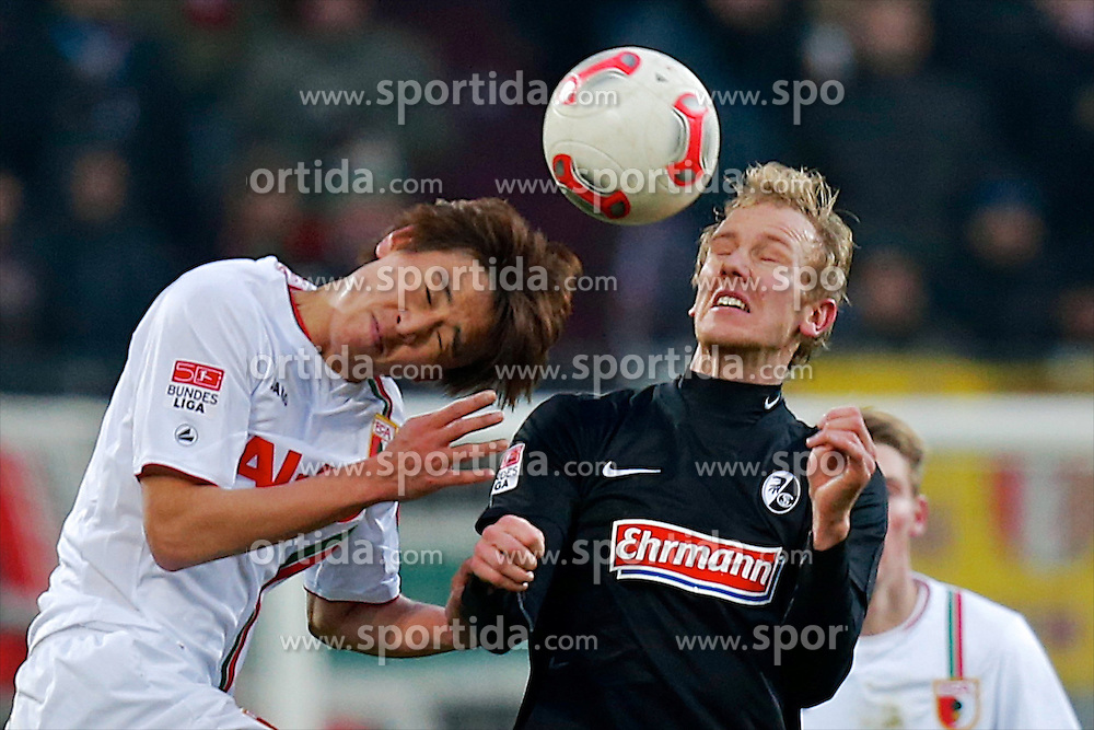 01.12.2012, SGL Arena, Augsburg, GER, 1. FBL, FC Augsburg vs SC Freiburg, 15. Runde, im Bild Gleich trifft Ja-Cheol Koo (# 14, FC Augsburg) li. mit seinem Kopf die Nase von Jan Rosenthal (# 8, SC Freiburg) und bricht ihm diese // during the German Bundesliga 15th round match between FC Augsburg and SC Freiburg at the SGL Arena, Augsburg, Germany on 2012/12/01. EXPA Pictures © 2012, PhotoCredit: EXPA/ Eibner/ Peter Fast..***** ATTENTION - OUT OF GER *****