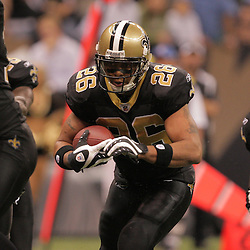 2008 November, 24: New Orleans Saints running back Deuce McAllister (26) finds a hole in the Packers defense on his way to a touchdown run during 51-29 victory by the New Orleans Saints over the Green Bay Packers on Monday Night Football at the Louisiana Superdome in New Orleans, LA.