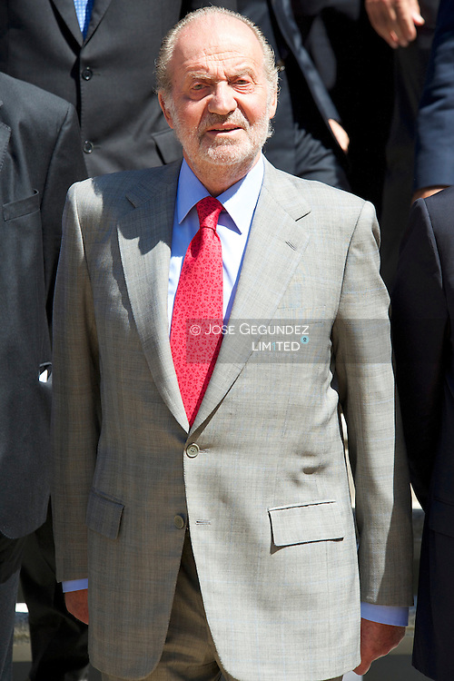 Spanish King Juan Carlos I attends an Audience to a representation of the International Motor Show of Barcelona at Zarzuela Palace in Madrid