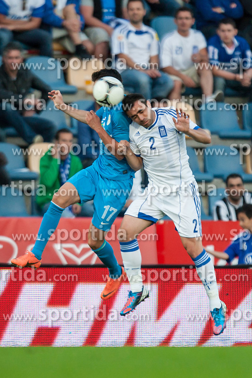 26.05.2012, Kufstein Arena, Kufstein, AUT, SLFC Summerleague, Griechenland vs Slowenien, im Bild Andraz Kirm, (SLO, # 17) vs Maniatis Ionannis, (GRE, #02 )// Andraz Kirm, (SLO, # 17) vs Maniatis Ionannis, (GRE, #02  during friendly Football Match between the Nationateams of Greece and Slovenia at the Kufstein Arena, Kufstein, Austria on 2012/05/26. EXPA Pictures © 2012, PhotoCredit: EXPA/ Juergen Feichter