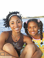 Two young Cuban girls on Malecon, Cuba, Havanna