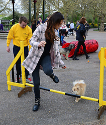 Lucy Watson launches Bark in the Park for Match.com. Made in Chelsea star Lucy Watson walks with her German Spitz, Digby in the lunch of 'Bark in the Park', a Match.com event for single Londoners and their dogs to meet fellow dog-owners in search of a date. Battersea Park Events Arena, London, United Kingdom. Saturday, 5th April 2014. Picture by Nils Jorgensen / i-Images