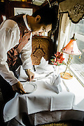 Setting table for lunch service on the Eastern & Oriental Train