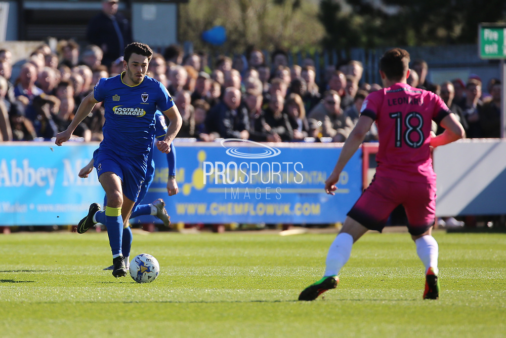 AFC Wimbledon defender Will Nightingale (5) taking on Southend United defender Ryan Leonard (18) during the EFL Sky Bet League 1 match between AFC Wimbledon and Southend United at the Cherry Red Records Stadium, Kingston, England on 25 March 2017. Photo by Matthew Redman.