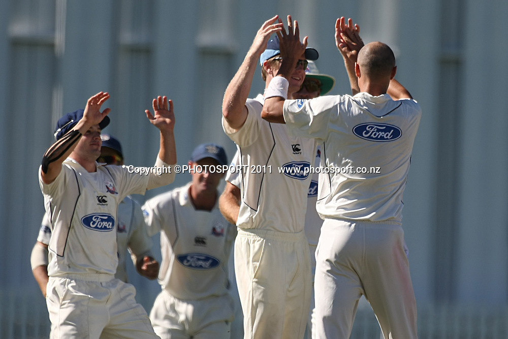 Chris Martin is joined by his team mates after getting BJ Watling out for a duck ,Cricket, Northern Knights Vs The Auckland Ace's during day four of their Plunket Shield Game at Seddon Park in Hamilton, Thursday 17 March 2011.<br /> Photo: Dion Mellow / photosport.co.nz