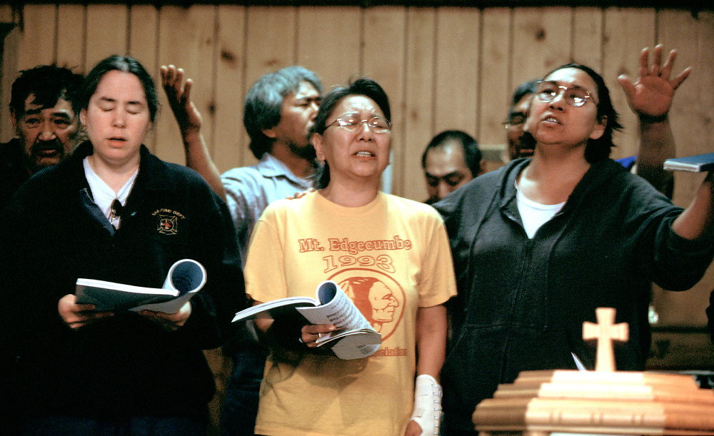 A group of people sing during the I&ntilde;upiaq service at the Presbiterian Church. The church is over a hundred years-old.<br /> <br /> May 18, 20:30