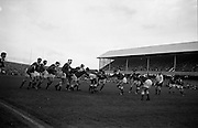 Rugby International, Ireland v Wales, Lansdowne Road, Dublin.  Irish forwards, Mulcahy and McBride, lead a dangerous foot rush.<br /> 17.11.1962