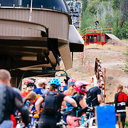 Andrew Whiteford gets air over the old tram car jump at Jackson Hole Mountain Resort while a Friday Night Bikes crowd watches.