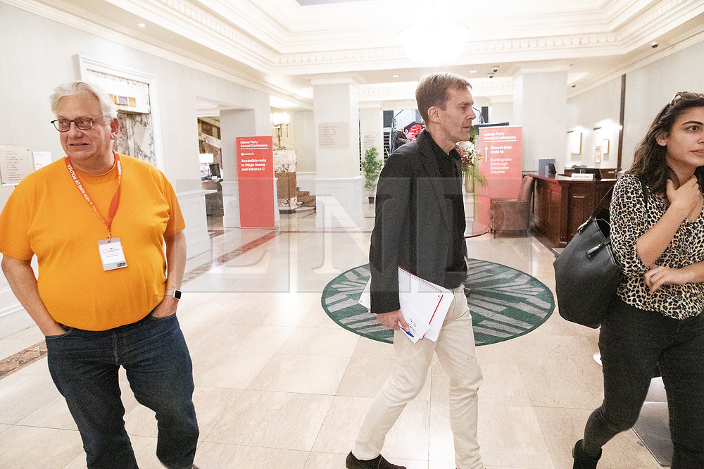© Licensed to London News Pictures . 20/09/2019. Brighton, UK. Momentum founder JOHN LANSMAN and SEUMAS MILNE are seen in the Hilton Brighton Metropole Hotel , which hosts a number of Labour fringe events , after a meeting of the National Executive Committee this evening (Friday 20th September 2019). The Momentum founder proposed a motion to scrap the post of Deputy Leader at the meeting . The Deputy Leader's post is currently occupied by Tom Watson . Lansman cited Watson's disloyalty over Brexit as motive for the motion . The 2019 Labour Party Conference from the Brighton Centre . Photo credit: London News Pictures