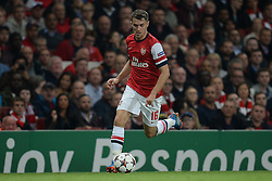 LONDON, ENGLAND - Oct 01: Arsenal's midfielder Aaron Ramsey from Wales runs with the ball during the UEFA Champions League match between Arsenal from England and Napoli from Italy played at The Emirates Stadium, on October 01, 2013 in London, England. (Photo by Mitchell Gunn/ESPA)