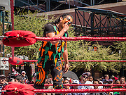 16 SEPTEMBER 2012 - PHOENIX, AZ:  Lucha Libre wrestler PEQUENO HALLOWEEN checks to see if he lost a tooth during a Lucha Libre exhibition match on Hispanic Heritage Day in Phoenix. The Arizona Diamondbacks hosted their 14th Annual Hispanic Heritage Day, Sunday to kick off Hispanic Heritage Month (Sept. 15-Oct. 15) before the 1:10 p.m. game between the D-backs and San Francisco Giants. The main attraction of the Day was three Lucha Libre USA exhibition wrestling matches in front of Chase Field stadium before the game.   PHOTO BY JACK KURTZ
