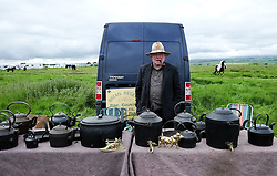 © Licensed to London News Pictures. <br /> 05/06/2014. <br /> <br /> Appleby, Cumbria, England<br /> <br /> Brian Regent sells pots and pans as gypsies and travellers gather during the annual horse fair on 5 June, 2014 in Appleby, Cumbria. The event remains one of the largest and oldest events in Europe and gives the opportunity for travelling communities to meet friends, celebrate their music, folklore and to buy and sell horses.<br /> <br /> The event has existed under the protection of a charter granted by King James II in 1685 and it remains the most important event in the gypsy and traveller calendar.<br /> <br /> Photo credit : Ian Forsyth/LNP