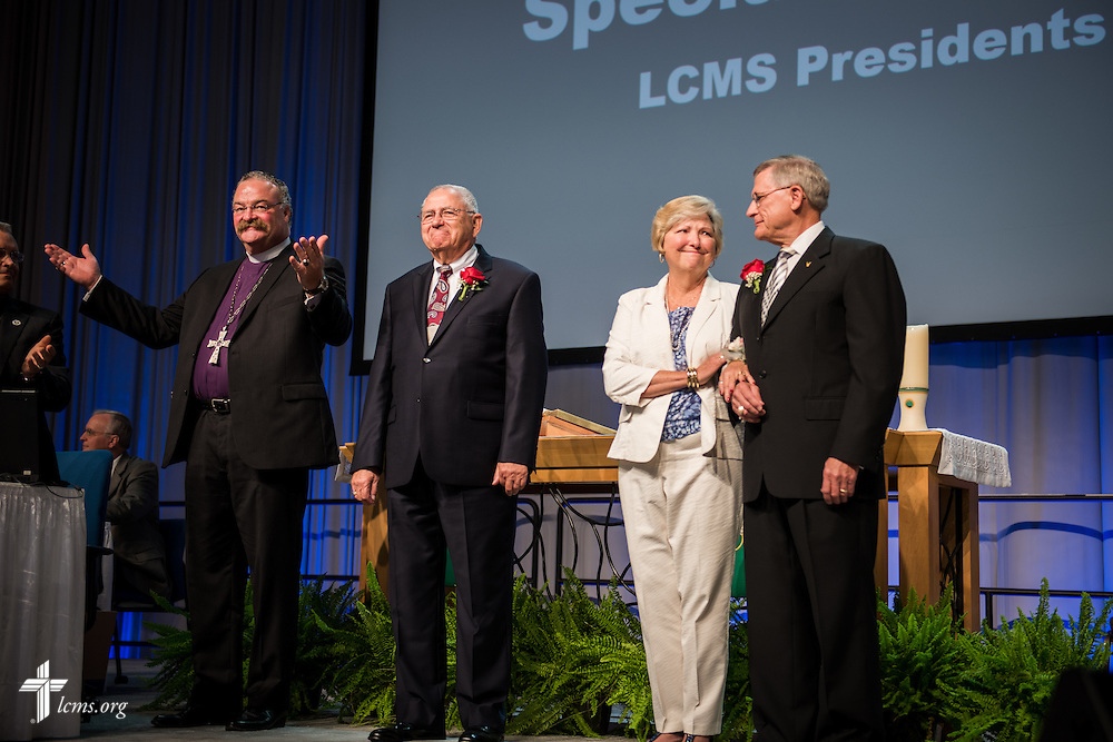 "LCMS President Rev. Dr. Matthew C. Harrison leads the convention's greeting and grateful acknowledgement of ""presidents emeriti"" attending the convention on Wednesday, July 13, 2016, in Milwaukee. To Harrison's left are the Rev. Dr. Robert T. Kuhn, Terry Kieschnick and the Rev. Dr. Gerald B. Kieschnick. LCMS/Frank Kohn"