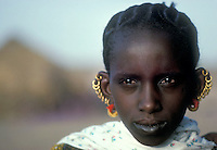 ca. 1978, Amadou Moussa, Mauritania --- Mauritanian Woman with Multiple Earrings --- Image by © Owen Franken/Corbis