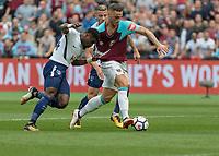 Football - 2017 / 2018 Premier League - West Ham United vs Tottenham Hotspur<br /> <br /> Serge Aurier (Tottenham FC)  grabs ahandful of Marko Arnautovic (West Ham United) shirt as he is through on goal at the London Stadium<br /> <br /> COLORSPORT/DANIEL BEARHAM