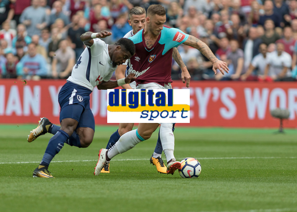 Football - 2017 / 2018 Premier League - West Ham United vs Tottenham Hotspur<br /> <br /> Serge Aurier (Tottenham FC)  grabs ahandful of Marko Arnautovic (West Ham United) shirt as he is through on goal at the London Stadium<br /> <br /> COLORSPORT/DANIEL BEARHAM