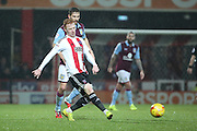 Brentford midfielder Ryan Woods (15) passing the ball during the EFL Sky Bet Championship match between Brentford and Aston Villa at Griffin Park, London, England on 31 January 2017. Photo by Matthew Redman.
