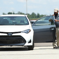 Jermaine McAllister and Dale Johnson, Quality Engineer's with Toyota Missisippi, lookk over one of the 10 cars being donated to ICC for their career and technoloy programs on Wednesday afternoon at the Blue Springs plant.