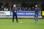 AFC Wimbledon first team coach Glyn Hodges watching the warm up during the EFL Sky Bet League 1 match between AFC Wimbledon and Rochdale at the Cherry Red Records Stadium, Kingston, England on 8 December 2018.