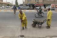 11/10/2014 -- Kirkuk, Iraq -- Two Bangladeshi workers clean the Shorja street.