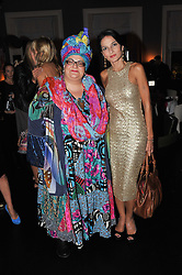 Left to right, CAMILLA BATMANGEILEDH and YASMIN MILLS at a dinner hosted by Marlon and Nadya Abela in aid of Kids Company at Morton's, Berkeley Square, London on 25th September 2012.