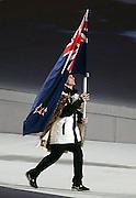 New Zealand flag bearer Shane Dobbin enters the stadium during the Sochi 2014 Winter Olympics Opening Ceremony in the Fisht Olympic Stadium on February 7, 2014 in Sochi, Russia. Photo: Ian MacNicol/www.photosport.co.nz