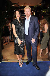 BORIS BECKER and his wife SHARLELY at the Ralph Lauren Wimbledon Party held at Ralph Lauren, 1 New Bond Street, London on 17th June 2010.