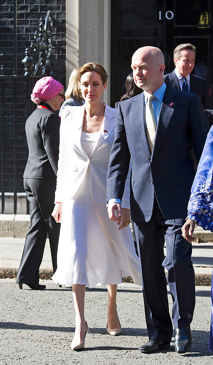 10.06.2014, LONDON: ANGELINA JOLIE FASHION FAUX-PAS<br /> Wearing a white summery dress Angelina Jolie gave viewers a bit more of her figure in what turned out as a see-thru dress<br /> ahead of the start of the End Sexual Violence In Conflict Summit in London.<br /> Jolie met with Britsh Prime Minister David Cameron at No.10<br /> Miss Jolie together William Hague is chairing the summit being held at the Excel, London<br /> Mandatory Photo Credit: Dias/NEWSPIX INTERNATIONAL<br /> <br /> **ALL FEES PAYABLE TO: &quot;NEWSPIX INTERNATIONAL&quot;**<br /> <br /> PHOTO CREDIT MANDATORY!!: NEWSPIX INTERNATIONAL(Failure to credit will incur a surcharge of 100% of reproduction fees)<br /> <br /> IMMEDIATE CONFIRMATION OF USAGE REQUIRED:<br /> Newspix International, 31 Chinnery Hill, Bishop's Stortford, ENGLAND CM23 3PS<br /> Tel:+441279 324672  ; Fax: +441279656877<br /> Mobile:  0777568 1153<br /> e-mail: info@newspixinternational.co.uk